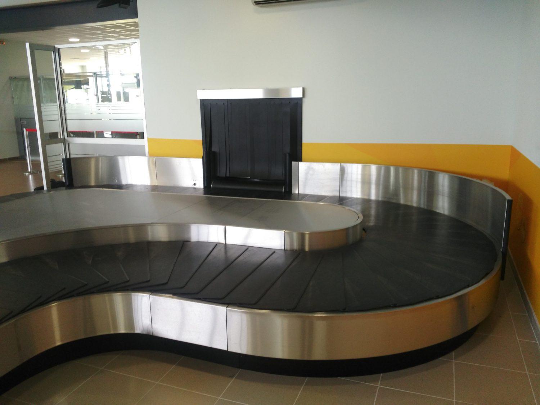 Carrousel livraison bagages courbe